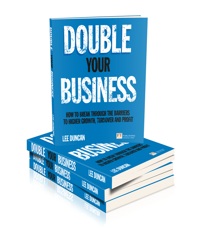 Double Your Business books in a pile