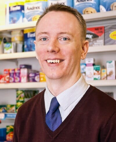 Tom McCullough at work in his rapidly growing business, Haydon Bridge Pharmacy