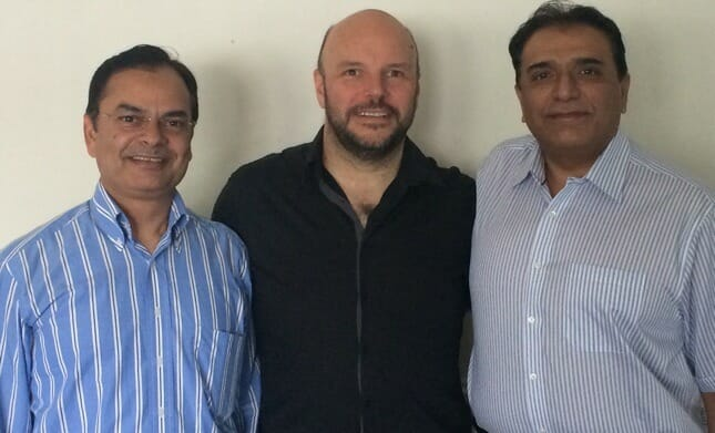 Lee with clients Jamal Shahid and Mohammad Akram.  Their business, Airworld Tours, grew £2 million with two years Double Your Business Coaching.  They've grown a further £6m since.