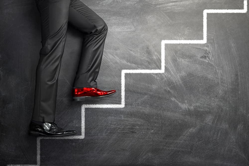 Step change in business red shoe